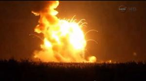 An unmanned Antares rocket is seen exploding seconds …