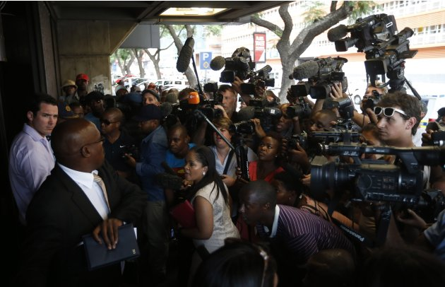 "Journalists wait outside the Pretoria Magistrates court during the bail application of ""Blade Runner"" Oscar Pistorius"