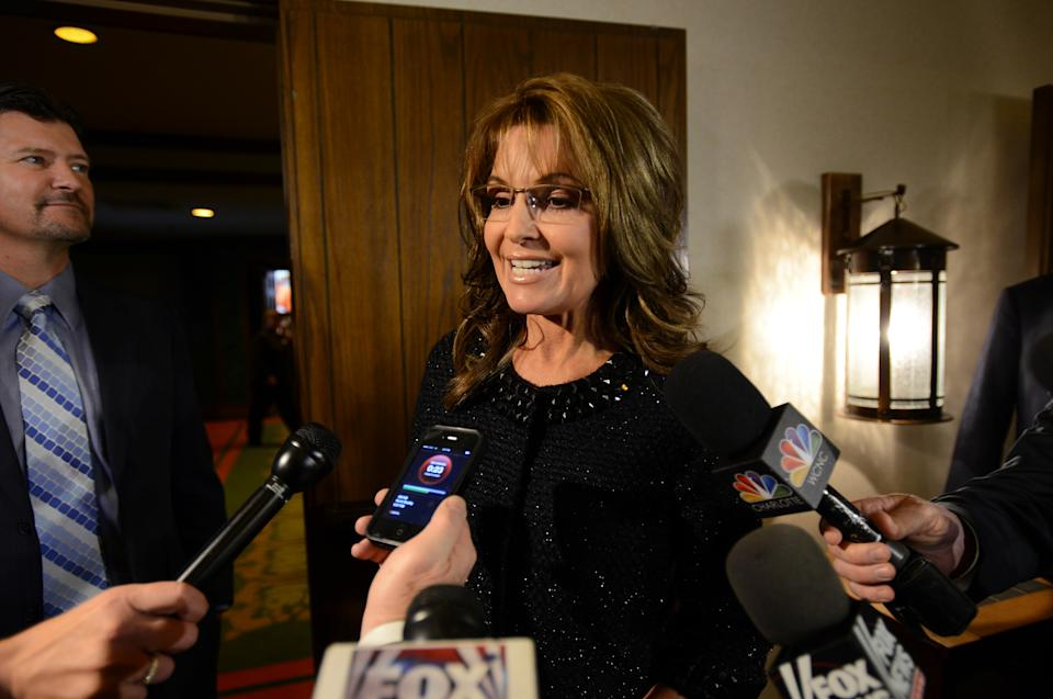Former Alaska governor Sarah Palin talks to the media before Billy Graham's 95th birthday party at the Grove Park Inn in Asheville, N.C., Thursday Nov. 7, 2013. (AP Photo/The Asheville Citizen-Times, Erin Brethauer) NO SALES