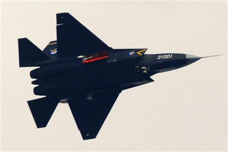 """A """"Guying"""" stealth fighter participates in a test flight in Shenyang, Liaoning province, October 31, 2012. REUTERS/Stringer"""