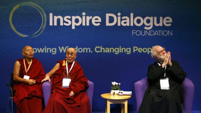 Tibetan spiritual leader, the Dalai Lama waits before speaking with ...