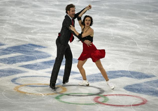 Pechalat and Bourzat of France during figure skating team ice dance short dance at Sochi 2014 Winter Olympics