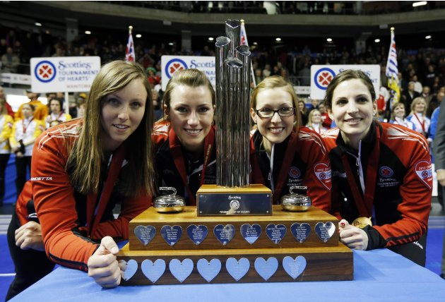 Ontario skip (L-R) Homan, Miskew, Kreviazuk, Weagle pose with the trophy during their gold medal game at the Scotties Tournament of Hearts curling championship in Kingston