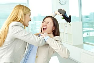 Woman fighting in an ofice
