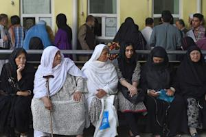 Afghan women wait as they apply for passports in Kabul…