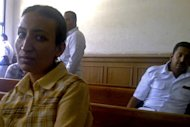 This Saturday, May 11, 2013 photo, provided by the lawyer of Dimyana Abdel-Nour, shows Abdel-Nour, 24, a Coptic Christian teacher, in a courtroom in the southern Egyptian city of Luxor, Egypt. Abdel-Nour, went from classroom to jail after lawyers and parents of three students filed a lawsuit accusing the teacher of insulting Islam. Freed on Tuesday, May 14, 2013, on a 20,000-pound (nearly 3,000 dollars) bail after nearly a week in detention, Abdel-Nour is due to stand trial later this month. Criminalizing blasphemy was enshrined in Egypt's new Islamist-backed constitution adopted in December. (AP Photo)