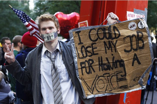 An Occupy Wall Street campaign demonstrator stands in Zuccotti Park, near Wall Street in New York