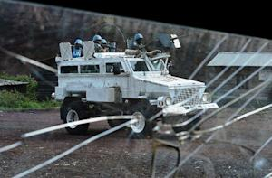 A FIB armoured vehicle of MONUSCO is pictured through …