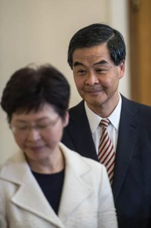 Hong Kong's Chief Executive Leung Chun-ying (R)…