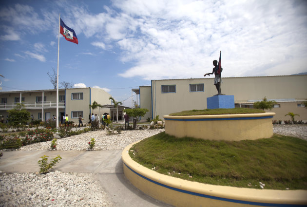 <p> In this March 15, 2013 photo, Haiti's national flag flies outside parliament which was renovated by Chemonics International Inc., a for-profit international development company based in Washington D.C., in downtown of Port-au-Prince, Haiti. A new report on American aid to Haiti in the wake of that country's devastating earthquake finds much of the money went to U.S.-based companies and organizations while just 1 percent went directly to Haitian companies. The obstacles blocking Haitian businesses from the contracts are many: they're often not competitive because they may not be able to get the financing they need from local banks, and smaller firms also lack the resources to prepare time-consuming applications and pay for the lobbyists and lawyers needed to win contracts. (AP Photo/Dieu Nalio Chery)