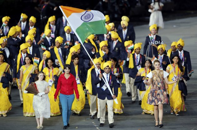India's flag bearer Sushil Kumar holds the national flag as he leads the contingent in the athletes parade during the opening ceremony of the London 2012 Olympic Games at the Olympic Stadium