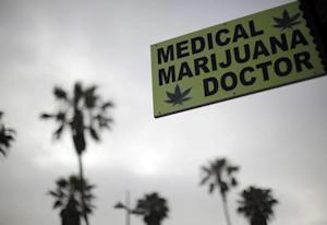 A sign advertises a medical marijuana dispensary on …
