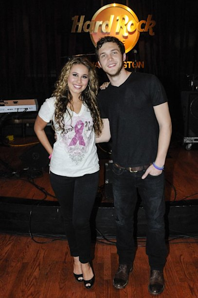 "Haley Reinhart, left, who placed third in the tenth season of ""American Idol"" and ""American Idol"" Season 11 winner Phillip Phillips, right,  kick off the Under 40 Music Marathon as part of Hard Rock's 12th Annual PINKTOBER breast cancer awareness campaign at Hard Rock Cafe, on Friday, Sept. 28, 2012 in Washington. (Invision for Hard Rock/AP Images)"