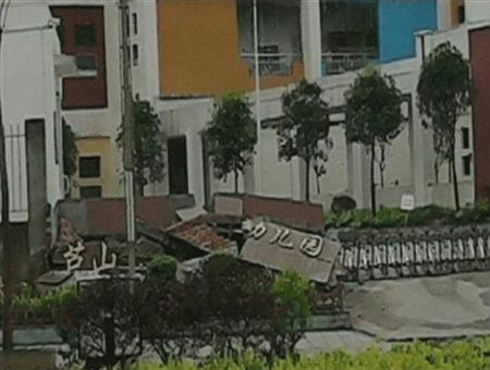 """A view of a collapsed building with a sign reading, """"Lushan Kindergarden"""" after a 6.6 magnitude earthquake hit southwestern China's Sichuan province is seen in this April 20, 2013 still image taken from TV. REUTERS/China Central Television (CCTV) via REUTERS TV"""