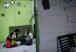 A Rohingya family rest in their rented house in Cheras …