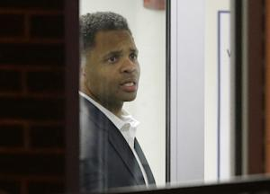 Former U.S. Rep. Jesse Jackson Jr. looks out of a window …