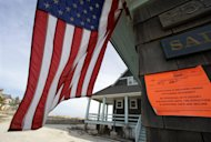 "In this Jan. 3, 2013, file photo, an unsafe for human occupancy sticker is attached to a home that was severely damaged two months ago by Superstorm Sandy in Bay Head, N.J. New Jersey Gov. Chris Christie, blasted his party's ""toxic internal politics"" after House Republicans initially declined to approve disaster relief for victims of Superstorm Sandy. He said it was ""disgusting to watch"" their actions and he faulted the GOP's most powerful elected official, House Speaker John Boehner, R-Ohio. The Republican Party seems as divided and angry as ever. Infighting has penetrated the highest levels of the House GOP leadership. Long-standing geographic tensions have increased, pitting endangered Northeastern Republicans against their colleagues from other parts of the country. Enraged tea party leaders are threatening to knock off dozens of Republicans who supported a measure that raised taxes on the nation's highest earners. (AP Photo/Mel Evans)"
