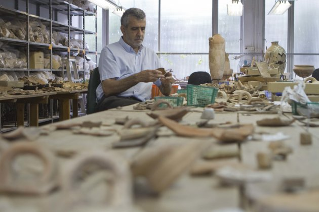 In this photo taken Wednesday, May 23, 2012 professor Israel Finkelstein sits in his desk at the Tel Aviv University, Israel. Israeli archaeologists have unearthed a stash of rare ancient jewelry near