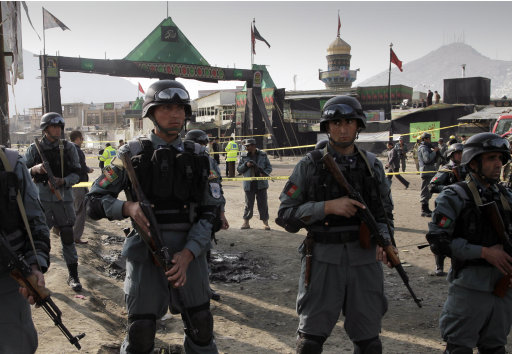 Afghan police officers stand guard at the scene of a suicide attack in Kabul, Afghanistan, Tuesday, Dec. 6, 2011. A suicide bombing tore through a crowd of Shiite worshippers marking a holy day Tuesday in the Afghan capital, the deadliest of twin attacks that killed scores of people in a rare burst of violence targeting the minority Islamic sect. (AP Photo/Musadeq Sadeq)