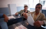 A couple cast their vote at a polling booth in Potocari, near Srebrenica, October 7, 2012. Bosnians, voting in the local elections, are likely to keep in power nationalist parties reflecting ethnic rivalries, 17 years after war ended. REUTERS/Dado Ruvic