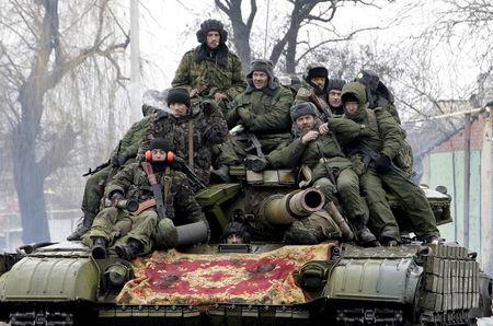 File photo of members of the armed forces of the separatist self-proclaimed Donetsk People's Republic driving a tank on the outskirts of Donetsk