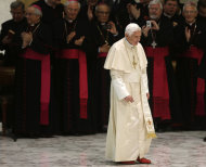 Pope Benedict XVI is applauded by prelates as he arrives for his weekly general audience in Hall Paul VI, at the Vatican, Wednesday, Dec. 19, 2012. (AP Photo/Alessandra Tarantino)
