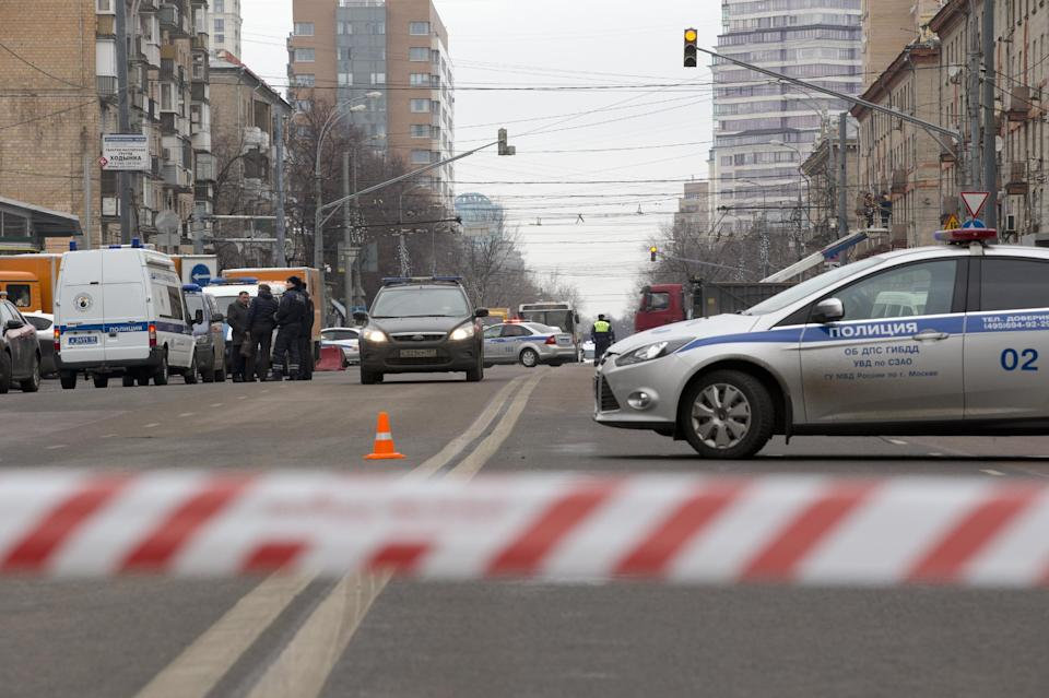 Police and the Investigative Committee  cars secure an area abound a subway station in Moscow on Monday, Feb. 29, 2016. Russian news agencies report...