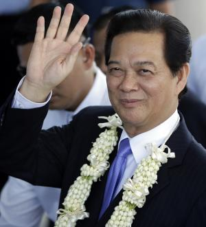 Vietnamese Prime Minister Nguyen Tan Dung waves to…
