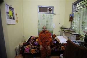 Wirathu, a Buddhist monk, poses for a photo in his …