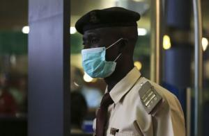 Immigration officer wears a face mask at the Nnamdi Azikiwe International Airport in Abuja