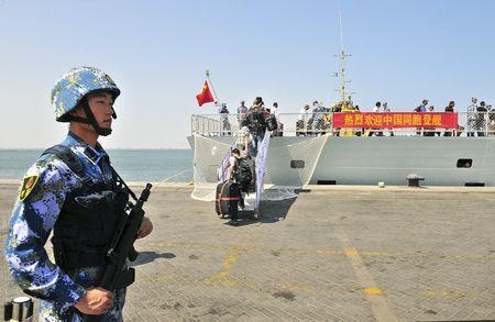 "File picture of a navy soldier of People's Liberation Army (PLA) standing guard as Chinese citizens board the naval ship ""Linyi"" at a..."