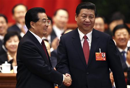 Hu Jintao (L) shakes hands with China's newly elected President and chairman of the Central Military Commission Xi Jinping during the fourth plenary meeting of the first session of the 12th National People's Congress (NPC) in Beijing, March 14, 2013. REUTERS/China Daily
