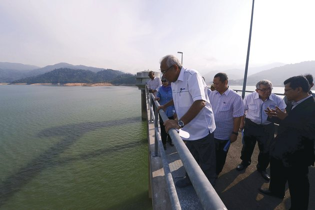 Running low Mahdzir looks at the level of water at the Sungai Selangor Dam which is left with 57.6 per cent of water.