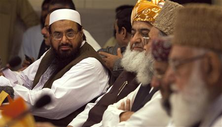 "Hafiz Saeed (L), the head of Jamaat-ud-Dawa and founder of Lashkar-e-Taiba, attends a conference for ""safeguarding the honour of the Prophet Mohammad"", with other political and religious leaders in Islamabad September 26, 2012. REUTERS/Faisal Mahmood"