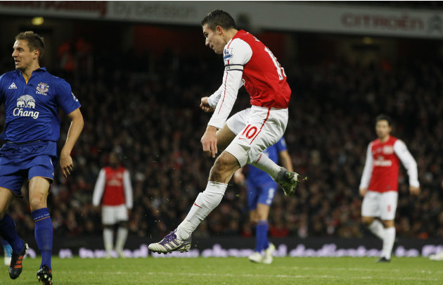 Arsenal's Robin Van Persie scores during the English Premier League soccer match between Arsenal and Everton at the Emirates Stadium in London, Saturday Dec. 10, 2011. (AP Photo/Kirsty Wigglesworth)