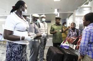 Nigerian custom officers wearing face masks and gloves…