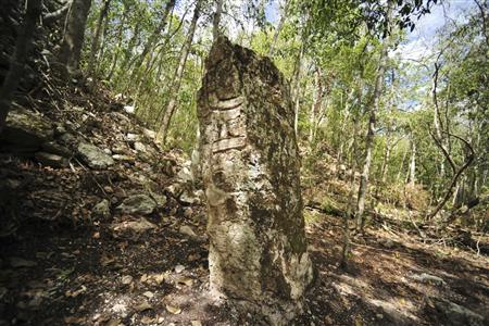 INAH handout photo shows a sculpted stone shaft called stelae at the newly discovered ancient Maya city Chactun in Yucatan peninsula