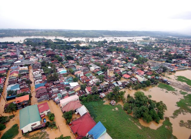 A Department of National Defense aerial photograph shows buildings and roads submerged by floodwaters in Rodriguez town, Rizal province, east of Manila August 8, 2012. Emergency workers and troops rushed food, water and clothes to nearly 850,000 people displaced and marooned from deadly floods spawned by 11 straight days of southwest monsoon rains that soaked the Philippine capital and nearby provinces. About 60 percent of Manila, a sprawling metropolis of about 12 million people, remained inundated on Wednesday, Benito Ramos, head of the national disaster agency, told Reuters. REUTERS/Department of National Defense/Handout (PHILIPPINES - Tags: DISASTER ENVIRONMENT) FOR EDITORIAL USE ONLY. NOT FOR SALE FOR MARKETING OR ADVERTISING CAMPAIGNS. THIS IMAGE HAS BEEN SUPPLIED BY A THIRD PARTY. IT IS DISTRIBUTED, EXACTLY AS RECEIVED BY REUTERS, AS A SERVICE TO CLIENTS