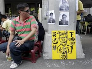 An activist looks at the papers with Taiwan's Education…