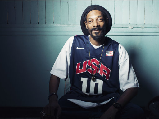 "This Monday, July 30, 2012 photo shows Snoop Dogg, who now goes by Snoop Lion, posing for a portrait at Miss Lily's in New York. Snoop Dogg says he was ""born again"" during a visit to Jamaica in February, changed his name to Snoop Lion and is ready to make music that his ""kids and grandparents can listen to.""  The artist known for gangster rap is releasing a reggae album called ""Reincarnated"" in the fall.  (Photo by Victoria Will/Invision/AP)"