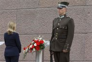 U.S. Secretary of State Hillary Rodham Clinton pays her respects at the Freedom Monument in Riga June 28, 2012. REUTERS/Haraz N. Ghanbari/Pool
