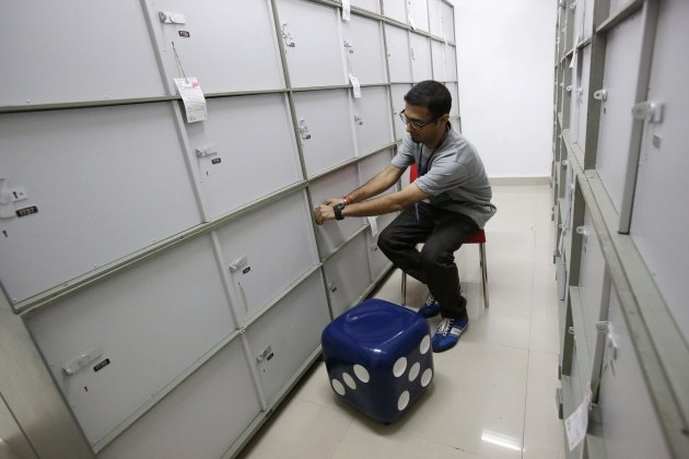A staff member works inside the safety deposit locker room at a HDFC Bank branch in Mumbai