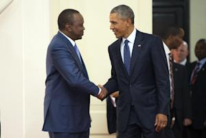 President Barack Obama, right, shakes hands with Kenyan …