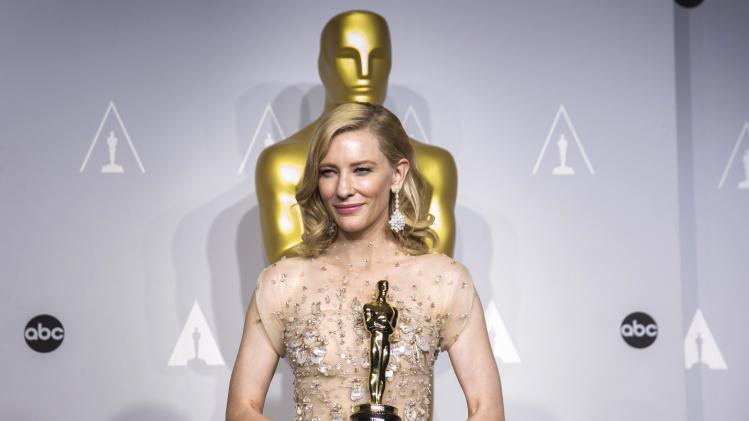 "Cate Blanchett holds her Oscar for Best Actress for the film ""Blue Jasmine"" at the 86th Academy Awards in Hollywood, California"