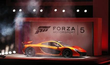 "A McLaren P1 is showcased during a presentation for the game ""Forza Motorsport 5"" during the Xbox E3 Media Briefing at USC's Galen Center in Los Angeles"