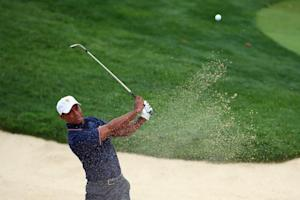 Tiger Woods of USA hits his second shot on the 4th…