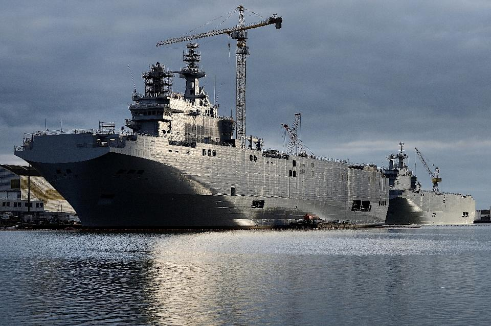 A picture shows the Sevastopol (L) and the Vladivostok warships, two Mistral class LHD amphibious vessels ordered by Russia from STX France in Saint-...