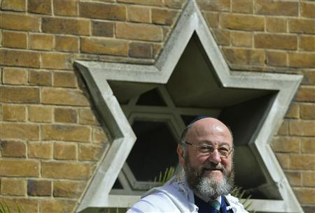 Chief rabbi-designate, Ephraim Mirvis, waits for Prince Charles to arrive to attend his installation as chief rabbi, at St John's Wood Synagogue in London September 1, 2013. REUTERS/Toby Melville
