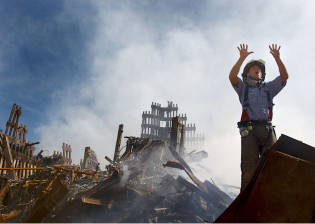 A New York City fireman calls for ten more rescue workers to make their way into the rubble