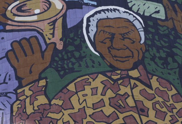 A giant portrait of former president Nelson Mandela adorns a cooling tower of a now defunct power station in Soweto, South Africa, Monday, Dec 31, 2012. Mandela is recovering at his Johannesburg home since being hopitalized for a lung infection and undergoing gallstone surgery. (AP Photo/Denis Farrell)